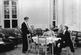 Actors and scene from Philip Barry's comedy Holiday  showing man and a woman seated at a dining...