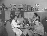 Friends socializing over bottles of beer at the Banquet Tavern, 1239 Jackson St., Seattle, 1955