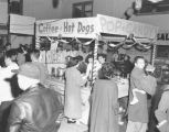 Asian-American citizens socializing at the Nisei Veterans Committee (NVC) Bazaar, November 6, 1955