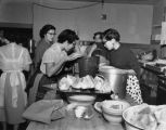 Asian American women preparing meal for the Washington Academy of Languages (WAL) chow mein dinner...