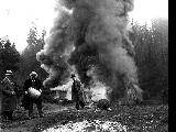 King County Sheriff Matt Starwich (left) and two men burning a still, ca. 1925