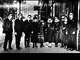 Stewart and Holmes Wholesale Drug Co. employees on 3rd Ave. during the 1918 Spanish Influenza...