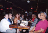 Jackie Boschok and other conference attendees sitting at restaurant table at the Coalition of...