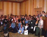 Group photograph of attendees at convention, 12th Biennial Coalition of Labor Union Women (CLUW)...
