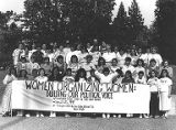 "Jackie Boschok with large group of summer school attendees holding ""Women Organizing..."