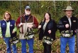 Jackie Boschok with Susan Palmer and two men preparing for clayshoot, 2nd Annual Puget Sound Union...