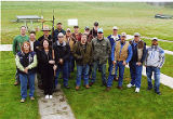 Jackie Boschok and Susan Palmer with large group of men at clayshoot, 2nd Annual Puget Sound Union...