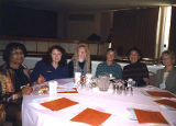 Jackie Boschok and others attendees at unidentifed banquet, ca. 1990s-2003