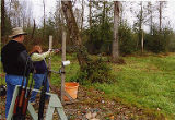 Jackie Boschok firing gun at clayshoot, 2nd Annual Puget Sound Union Sportsmen Alliance Sporting...