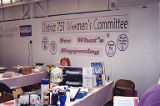 IAM 751 Women's Committee members sitting behind the International Association of Machinists (IAM)...
