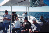 Jackie Boschok and others eating lunch aboard the fishing boat, IAM 751 Fishing Derby,...