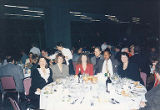Jackie Boschok sitting at banquet table with fellow convention attendees, International...
