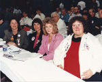 Jackie Boschok, Lois Hanson, Kathy Short and Jacky Neuman sitting at conference table,...