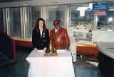 Susan Palmer and Sam Perry posing with large bell, International Association of Machinists (IAM)...