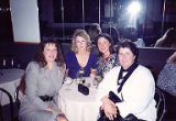 Susan Palmer, Kathy Short, Jackie Boschok and Jan Little seated at dinner table, International...