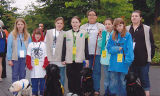 Girl scouts posing with Guide Dogs of America puppies, International Association of Machinists...