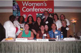 Group shot of Jackie Boschok and other conference attendees with IAM Women's Conference poster in...