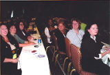 Jackie Boschok and other attendees sitting at conference tables, International Association of...