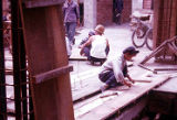 Construction site showing workers nailing wood, Trade Unionists tour of China, 1975