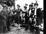 King County Sheriff Matt Starwich and four women dressed in Scottish attire at a ceremony to...