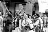 Bakke Decision Protest depicting people marching and holding protest signs in Seattle, Washington,...