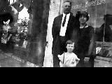 Arthur Boose and family outside of the Industrial Workers of the World hall, ca. 1910s-1920s