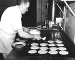 Cook making pancakes at Port of Seattle, n.d.