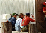 Men and women of various ethnicities outdoors in casual clothing, unidentified cannery, Alaska,...