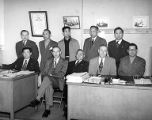 Ten men, mostly Filipino, during meeting of the Cannery Workers and Farm Laborers Union, Local 7,...