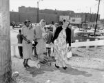 Three women using the Community Council (JSCC) pathway from the Safeway supermarket lot at 8th...