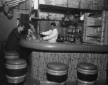 Bartender and a man sitting at the bar of the Nikko Sukiyaki Restaurant, 1306 King St., Seattle,...