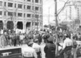 Gulf War protest outside the Federal Building in Seattle, Washington, with police in foreground,...