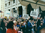 Crowd of Gulf War protesters, many making peace signs, Seattle, Washington, January 17, 1991