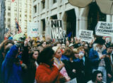 Gulf War protesters, making peace signs and holding signs and flags, Seattle, Washington, January...