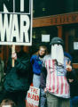 Gulf War protestors, one in costume, demonstrating outside the Federal Building in Seattle,...