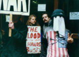 Gulf War protestors holding signs outside the Federal Building in Seattle, Washington, January 17,...