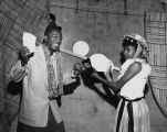 African American couple enjoying the carnival at Neighborhood House, 825 Yesler Way, Seattle, May...