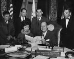 Washington State Governor Albert Rosellini meeting with a contingent of the Japanese American...