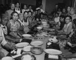 Asian women preparing meals for the Nisei Veterans Committee (NVC) Bazaar, November 2, 1958 or 1959