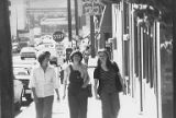 Sue Williams (center), Terri Mast (right) and an unidentified woman (left) walking on King Street...