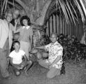 Mensalvas family under coconut tree, Punaluu, September 1961