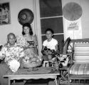 Tony, Topper Mensalvas, and Patsy Mensalvas in living room, Punaluu, September 1961