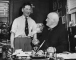 "James ""Jimmie"" Yoshinori Sakamoto socializing with a colleague at the St. Vincent de..."