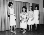 Asian American Queen and Princesses learning to curtsy at a local charm school, June 13, 1963
