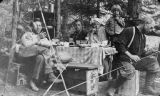 R.C. Lichty, Carroll Webber, Mrs. Lichty and her son, and Mr. Webber picnicking near the Satus...