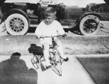 Frank Skillern on a tricycle at Mrs. Skillern's in Dallas, Texas, September 8, 1918
