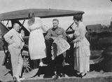 Jimmy, Mary, John and Mrs. Skillern getting ready for a dinner party, Camp Dick, Dallas, Texas,...