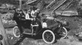 Group of seven young men in an automobile with a fish, June 1910