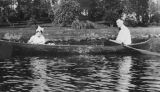 Etta Barter and Earl Winters in a rowboat at Laurelhurst Point, May 1915