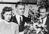 Eino Moks with parents after his confirmation at the displaced persons camp in Geislingen,...